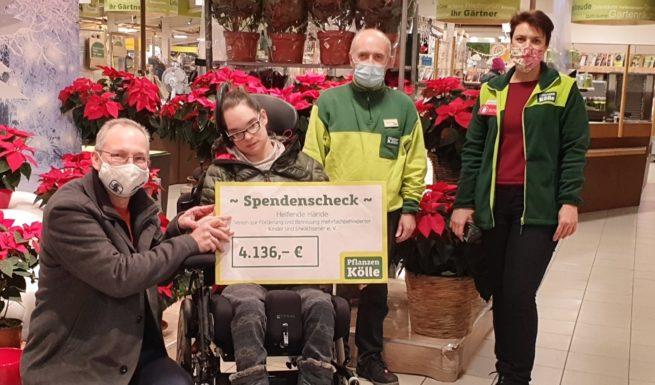 Spendenübergabe bei Pflanzen Kölle für das neue Förderzentrum